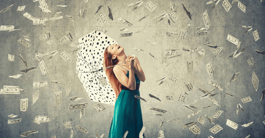 a woman standing in the money rain